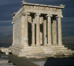 Temple of Athena Nike. Built in  421 b.C. in Athens, Greece. It was built for the winged goddess of victory.  It has 13 ft (4 m ) in height, and a base measuring 27 X 18 ft (8.2 X 5.4 m).