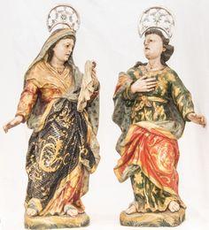 Duas imagens em madeira policromada representando São João e Nossa Senhora ao pé da Cruz. Bahia, Século XVIII. Vendido 9.000,00.