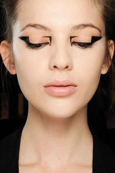 MAKEUP- I liked this fashion makeup because it is very simple but could definitely tie in easily with a specific wardrobe/collection.  I like how the emphasis is at the outer and inner corners, leaving the middle bare.