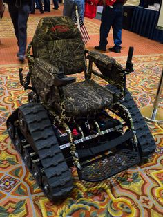 The Action TrackChair was on display at SHOT Show. It allows wheelchair users go off road into the fields or forests to hunt. Optional accessories include a camouflage finish and a gun rack. Its 24 volt DC 24:1 ratio high torque motor give this 390 lbs machine a max speed of 3-4 mph. The two 12 volt wheelchair …   Read More …