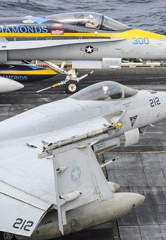 """GULF OF OMAN (Aug. 20, 2013) An F/A–18C Hornet, top, assigned to the """"Blue Diamonds"""" of Strike Fighter Squadron (VFA) 146, and an F/A-18E Super Hornet, assigned to the """"Argonauts"""" of Strike Fighter Squadron (VFA) 147 prepare to launch from the flight deck of the aircraft carrier USS Nimitz (CVN 68). (U.S. Navy photo by Mass Communication Specialist 3rd Class Nathan R. McDonald/Released)"""