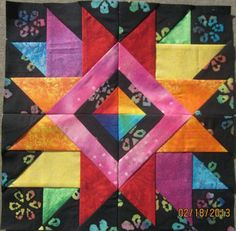 Carol Doak Block (love the center with four different colors)