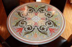 Vibrant pop of color on this round farm table! Beautiful stenciling by Deelite Design.  Modello® Designs Ornamental Center Stencil (OrnCen130).
