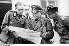 General of Panzer Troops Walter Krueger (center), commander of  LVIII. Panzer Corps and Colonel Henry Bronsardt von Schellenberg (left) discuss the tactical situation in France, June 21, 1944.