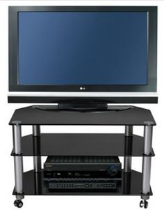 "Stil Stand Glass Tv Stand / Glass TV Trolley up to 32"". STUK1401 BL/CA      Suits up to 32"" LCD/Plasma TV     Black Glass Shelves     Toughened Safety Glass     Aluminium Legs     All of our black glass TV stands are compatible with most popular brands of television.  Dimensions: 800mm (w) x 400mm (d) x 507 (h)  mm  STUK1401BLCA."