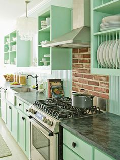 This pastel kitchen retains its edge with a brick backsplash. // #Kitchen #Backsplash Ideas - Better Homes and Gardens - BHG.com