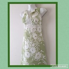 """Ann Taylor floral dress with lace bodice This lovely dress is exquisitely tailored with an empress cut and lace trimmed bodice to accentuate body curves. Very flattering design in soft green and white. It has never been worn, fully lined and 100% cotton. Measures 37"""" length from shoulder to hem Bust is 17"""" across the front Bodice at lace area is 14.5"""" across the front Ann Taylor Dresses"""