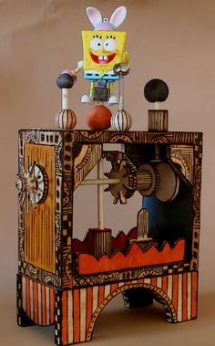 ©2012 Phyllis Harland  Wooden kinetic art sculpture.  Available at www.streetdogart.com  $89