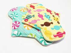 Etsy.com is one of the best places for cloth pads; hundreds of independent sellers at cheap prices so you can build-up your stash and try different styles or materials without committing to one brand or spending a fortune. Pads in photo are Lady Days Cloth Pads.