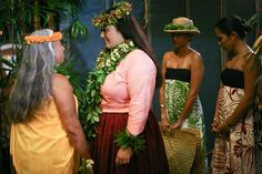 Lilinoe Sterling, Miss Aloha Hula 2012,  sharing a private moment with kumu Mapuana de Silva of Halau Mohala 'Ilima before her hula kahiko.