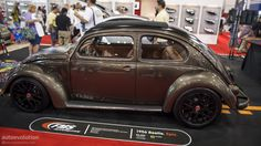 """FMS Automotive unveiled this awesome looking 1956 Beetle to this year's SEMA Show, a fully restored car with a touch of the modern age. Their booth also came with a 2012 model for that """"then and now"""" combination."""