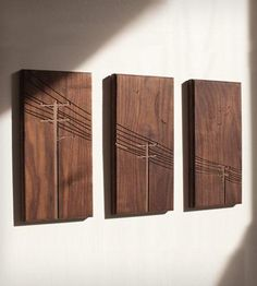 "Power poles triptych, CNC routed in solid walnut. Dimensions: 6"" x 12""."