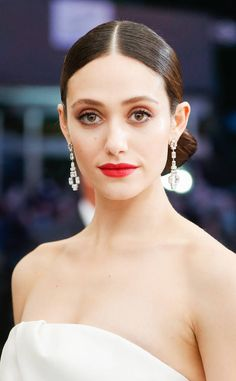 Emmy Rossum from 2017 Met Gala: Best Accessories  The diamond-drop earrings perfectly framed the actress' face (and helped show off her red lip color, too).