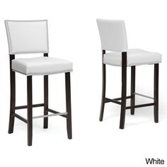 Show your sophisticated side by making these handsome modern bar stools play important roles in your decor. The black frames include built-in stainless-steel footrests that offer comfort, while the faux-leather seats feature pretty silver trim.