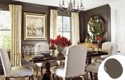 The cocooning color on these faux-paneled walls helps harmonize the varied wood tones throughout the room. But that's only part of the story. Extending the deep shade to the crown and panel moldings and to the windows and their trim gives the space a seamless look—and the airy white ceiling a lift. For a similar look, try: Glidden Wild Truffle
