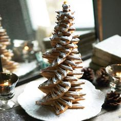Christmas Tree of Cookies Recipe - This recipe for a Christmas tree of cookies is really a stack of star-shapped cookies that are arranged from large to small. A great centerpiece.