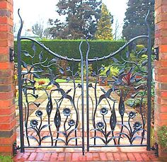 Swallows sculptural gate for private house, Hartlebury, Worcestershire.   The house martins and swallows that fill the summer air in this garden inspired the design for these gates.