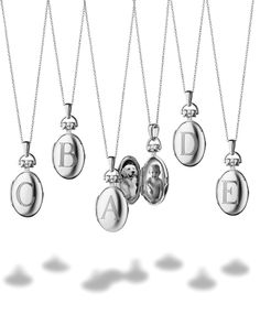 Monica Rich Kosann Petite Sterling Silver Initial Locket Necklaces. For more Monica Rich Kosann jewelry visit London Jewelers Americana Manhasset or call 516-627-7475 to speak to a store representative.
