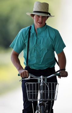 In this July 13, 2011, photo, an Amish boy rides home for lunch after a morning of hauling hay in Centerville, N.Y.