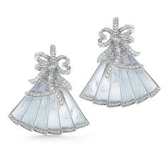 18k white gold earrings from the Belle Epoque collection feature a fan design lined with mother-of-pearl, and a diamond-studded bow on top of each.