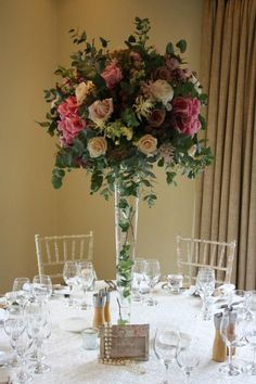 Tall table arrangement Tall Flower Arrangements, Tall Flowers, Vase Arrangements, Wedding Flower Arrangements, Bridal Table, Wedding Table Flowers, Wedding Bouquets, Flower Centerpieces, Wedding Centerpieces