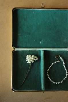 a box of flowers and pearls