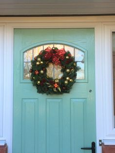 Luxury fresh blue pine Christmas door wreath with red ribbon and festive decorations - created by Willow House Flowers Aylesbury florist - www.willowhouseflowers.co.uk