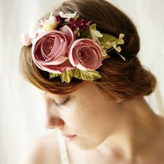 To give an idea of exactly what I want, the fascinator will have flowers like these large pink ones but in a redder color, with the whole thing looking like the next one.
