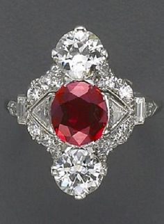 An Art Deco ruby, diamond and platinum ring, Raymond Yard, circa 1920. The lozenge-shaped panel centring an oval-shaped ruby flanked by triangular-shaped diamonds and old European-cut diamonds above and below, pavé-set diamonds throughout the remainder, completed by baguette-cut diamond shoulders and a plain hoop; signed Yard, Inc. #RaymondYard #ArtDeco #ring