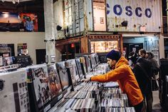 you-are-the-sound-of-settling:Ben Gibbard record shopping Photo by Ryan Muir (of Stereogum) // taken from this article