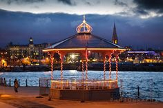 Xmas lights on the bandstand - the Royal Marine Hotel (Dun Laoghaire) is on the LHS int he distance Places To See, Places To Travel, Where Do I Go, Xmas Lights, Dublin City, Taste Of Home, Fun Events, Live In The Now, Gazebo