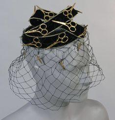 Woman's hat (side view) | United States, circa 1966 | Designed by Benjamin Green-Field (American, 1897-1989). Label Bes-ben, Chicago, founded 1920 | Black silk velvet, gold metallic scissors, black veiling | Philadelphia Museum of Art
