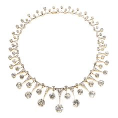 DIAMOND NECKLACE, LATE 19TH CENTURY Designed as a graduating row of lanceolated motifs, set with cushion-shaped, circular-cut and rose diamo...