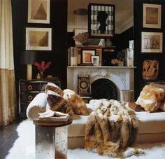 The fur pillows and blanket add warmth and even more luxury to this beautiful room.