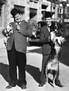 Oliver Hardy and Stan Laurel 1932 and pups, cute, right