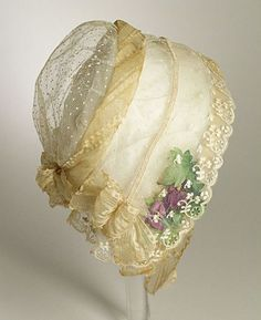 A beautiful, delicate sheer lace bonnet from 1840