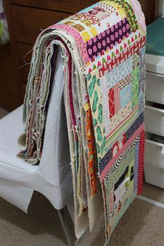 Quilt-As-You-Go-blocks to batting...and then add backing, quilting only in the ditch between blocks...interesting...it lets the quilting inside the blocks be creative, but you'r not dealing with the whole quilt and the back is just squares.