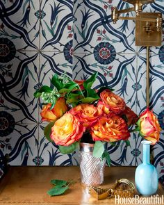 Chrome ContainerFor a glam look, try using a metallic vase. It will make your flowers look even more upscale, like these colorful roses on a bedside table in aBrooklyn townhouse.