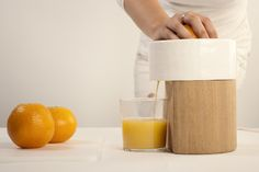 """Natalia Coll's beautiful Edwin Juicer - """"fully repairable and sustainable fruit squeezer"""" made of wood and ceramic"""