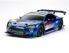 The Tamiya R/C Subaru BRZ R Sport - TA06 Model Kit is a 1/10 scale radio controlled car in the tamiya on-road range.    Subaru created the Subaru BRZ R Sport race car for the GT300 racing class during the 2012 Super GT season. The BRZ from Team R Sport features a 2-liter turbocharged boxer 4-cylinder engine capable of over 300hp, a 4-wheel double wishbone suspension actuated via pushrods, and a sleek body shape form with flared front/rear fenders, rear diffuser, and large rear wing.
