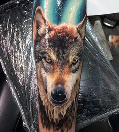 Realistic Forearm Wolf Sleeve Tattoos On Man