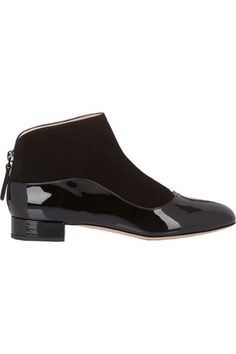 The Two-Toned Skimmer If you can't make a decision about what kind of bootie material to go with, this easy strider has contrasting matte-black suede and shiny patent-leather layering.  Giorgio Armani Back-Zip Ankle Boots, $795, available at Barneys New York.