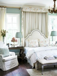 This sunny bedroom boasts traditional style at every turn, with elements such as the shapely headboard and the symmetrical arrangement of furniture: http://www.bhg.com/rooms/bedroom/master-bedroom/beautiful-boudoirs/?socsrc=bhgpin060314traditionalgrace&page=15