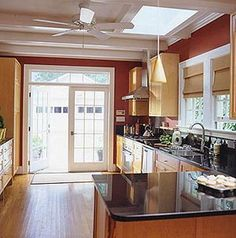 Paint the over the sink window trim, pantry door, basement door, lightbox white, dark granite counters, stainless steel appliances - Red Kitchen Walls | red+kitchen+Kitchen+and+Bath+Ideas.jpg