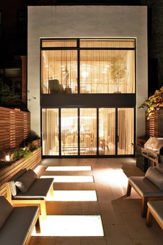   EXTERIOR   Backyard of townhouse at 67 Charles West Village, New York, NY. Turett Collaborative Architects created an architectural language to highlight the moments where old and new would interact in this space.