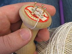 Spool weaving with beads (aka spool knitting or spool crochet)
