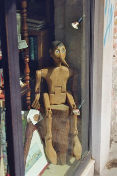 Pinocchio marionette in window. Get sensory, hands-on activity ideas for PINOCCHIO by Carlo Collodi and 40+ more great books at  http://www.litwitsworkshops.com/free-resources/ LitWits Kits make literature real, and fun for kids!