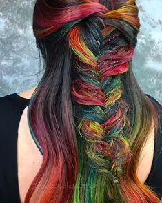 Technicolor Valayage on my model @starsofamillion  I used @brazilianbondbuilder both in the lightener to first balayage, then in my custom direct dyes. I used the @sexyhair Glow Getter glitter brush to snaz up my fishtail braid...just for funsies  Cannot wait to do some more fun hair for @behindthechair_com On Tour show next weekend! See you guys there. Get your tix 25% off using the code they gave me REBECCA25  #haircolor #rainbowhair #braids #hairstyle #hair #hairstyle @cosmestarbails...