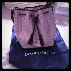 Get it now!Lowered for a little! Dooney &bourke!! Beautiful pattern, scratch and stain proof, tons of room inside and pockets, beautiful chevron design, brand new with tags and dust bag Dooney & Bourke Bags