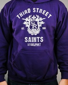 """Saints Row: The Third Crest Hoodie is purple with a distressed print, and it features a large version of the crest for the """"Third Street Saints, Steelport, Est. 2006."""" #SaintsRow #SR3"""